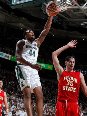 Michigan State's Nick Ward (44) dunks against Ferris State's Zach Hankins (35) Thursday, Oct. 26, 2017, in East Lansing, Mich. Michigan State won 80-72.