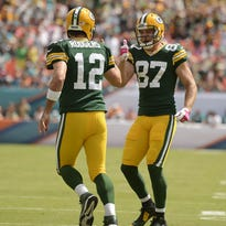 Green Bay Packers' Aaron Rodgers and Jordy Nelson celebrate their touchdown against the New England Patriots during the Week 13 game at Lambeau Field.
