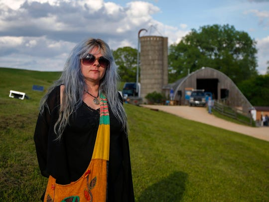 Tiffany Biehl, owner of the Codfish Hollow Barnstormers session venue in rural Maquoketa, stands near the barn where big-named musicians have performed. The most recent, Edward Sharpe and the Magnetic Zeros, played there on Tuesday, May 17, 2016.