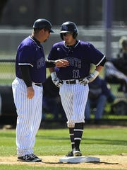 Hardin-Simmons head coach Steve Coleman talks with Taylor Cooling (11) during a pitching change in the bottom of the fifth inning of a game in 2016. Cooling was one of seven All-Americans Coleman has coached during his time with the Cowboys.