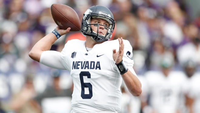 Wolf Pack quarterback Ty Gangi drops back to pass during the first quarter of Nevada's game at Northwestern.