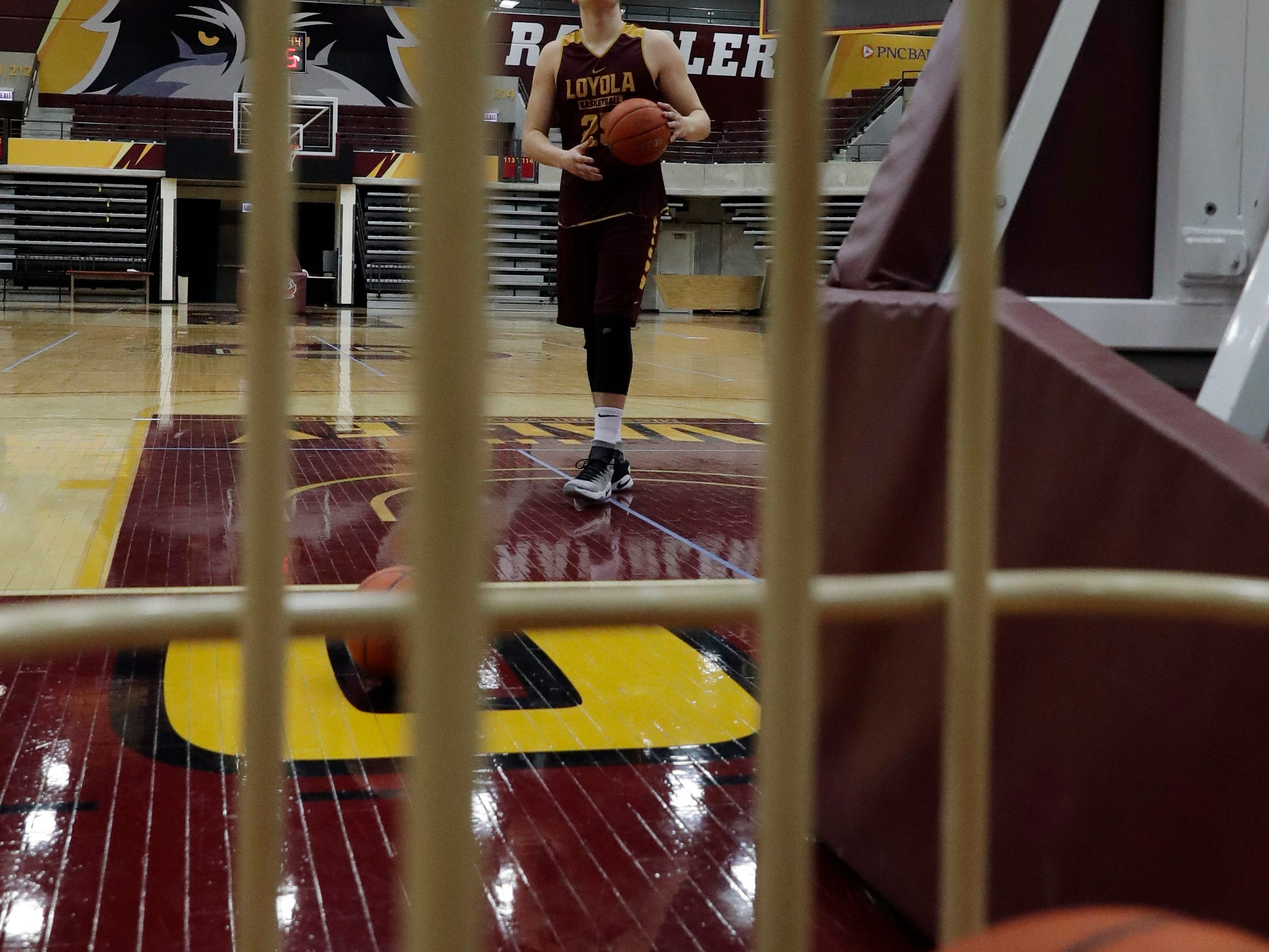Loyola center Cameron Krutwig looks to the basket during NCAA college basketball practice in Chicago, Friday, March 9, 2018. Loyola locks up 1st March Madness appearance in 33 years. (AP Photo/Nam Y. Huh)