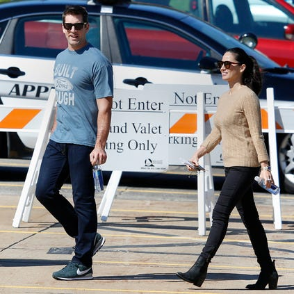 Green Bay Packers quarterback Aaron Rodgers and actress Olivia Munn walk to the set of a commercial filmed outside of the Fox Valley Performing Arts Center on Tuesday, September 16, 2014, in Appleton, Wis.  Joshua Bessex/ Post-Crescent Media