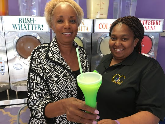 Candy Capel, left, opened CC's Daiquiris at its current spot in downtown Montgomery late last year. She said the change to the open container policy has hurt her business.