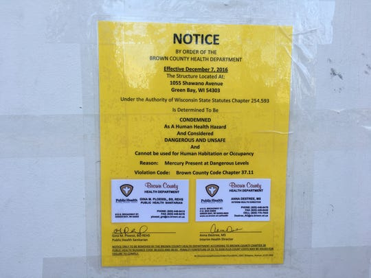 Notice of mercury contamination displayed at the single family home in the 1000 block of Shawano Avenue.