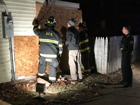 Burlington firefighters and other personnel help install