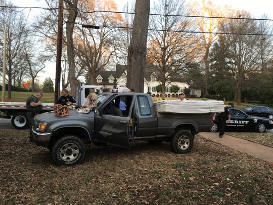 A gray Toyota ended up in the lawn of 407 Boulevard on Wednesday evening after Anderson County Sheriff Chad McBride attempted to get the driver to pull over.