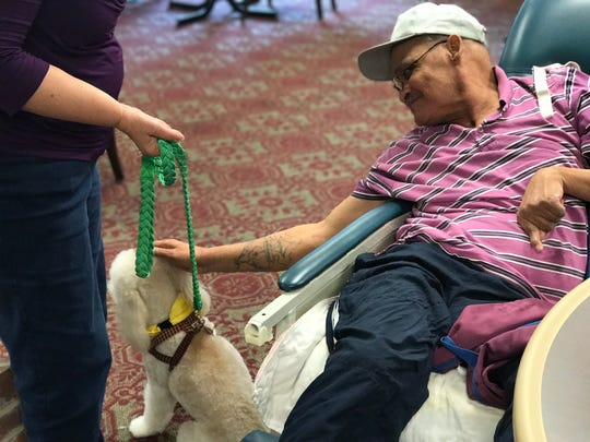 A resident at Naomi Heights Nursing and Rehabilitation Center in Alexandria enjoys a visit from the group, Pets & People Therapy Animals of Central Louisiana.