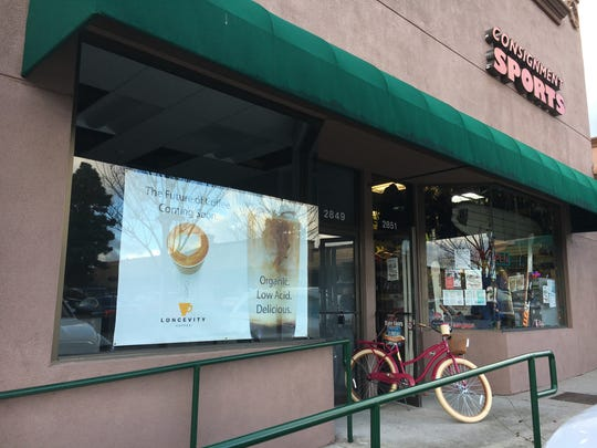 """A """"coming soon"""" banner for Longevity Coffee is seen in a window at the Skyline Plaza shopping center in Thousand Oaks."""