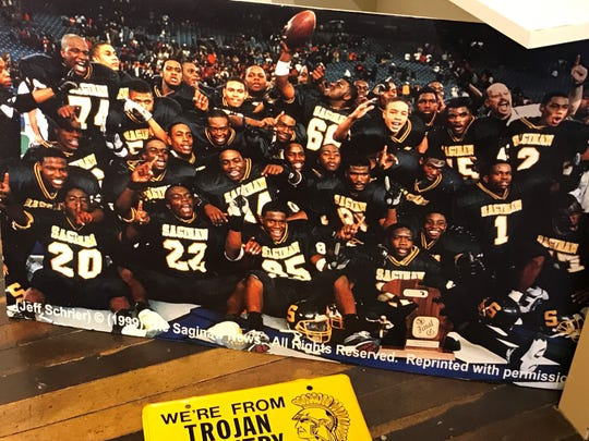 Charles Rogers (No. 22) celebrates with his Saginaw High School teammates after winning the 1999 state championship at the Pontiac Silverdome. This photo is on display at the Saginaw County Hall of Fame inside the Castle Museum.