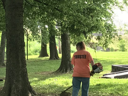 Members of the female work release crew from the Henderson County Detention Center mow and trim at Freedom Park located off Airline Road recently.