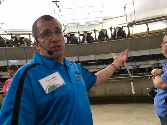 Kewaunee County farmer Randy Ebert talks about the rotary milking parlor on his farm near Algoma as part of a media day for the Kewaunee County Wisconsin Farm Technology Days scheduled for July 11-13.