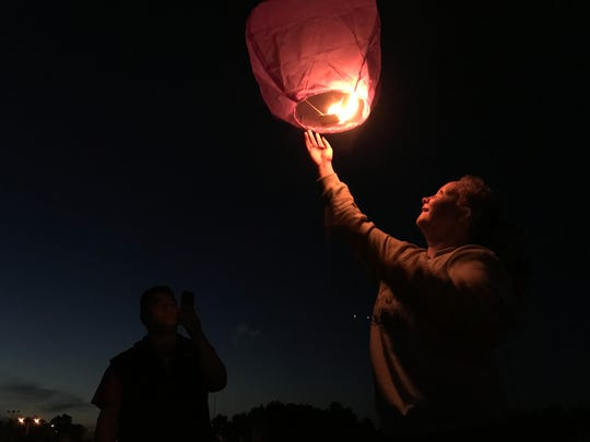 A floating lantern rises over Lincoln High School in Wisconsin Rapids.