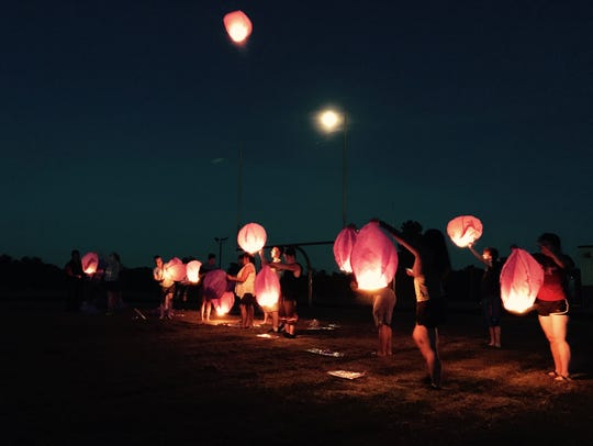 Lanterns float above the football field at Lincoln