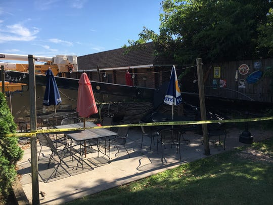 A crane crashed into the outdoor seating area at Uptown Lounge in Anderson.