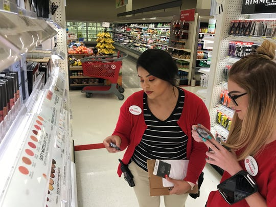 Gloria Moreno, left, Target cosmetics team leader and Cheyanne Lindgren, a Target cosmetics representative, talk about new products at the South Mooney Target in Visalia.