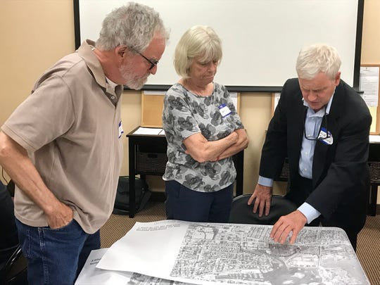 Alex Twining (right), CEO of Twining Properties, discusses site plans for Pratt Landing at Echo Bay with New Rochelle residents.