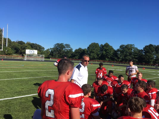636417909432109187-Governor-Livingston-coach-Dan-Guyton-addresses-his-team-following-Saturday-s-36-29-victory-over-North-Plainfield-9-23-17.JPG