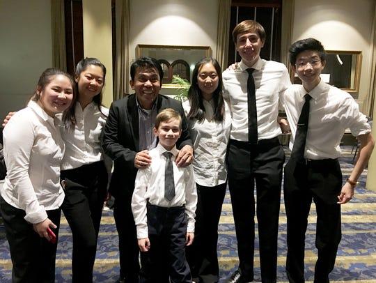 10th grade violinists Elizabeth Su and Kaela Kim were
