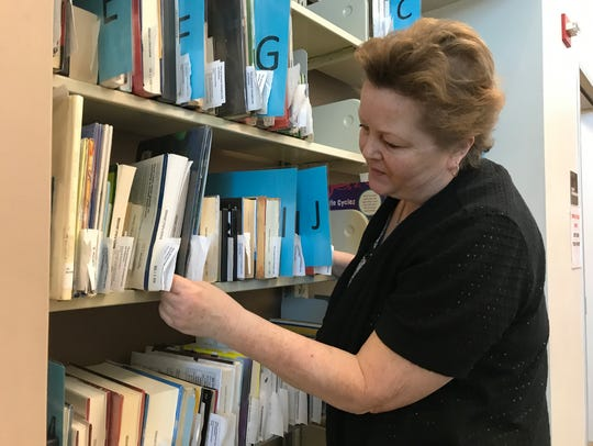 Redding Library employee Laurie Figuero is shown in this file photo.