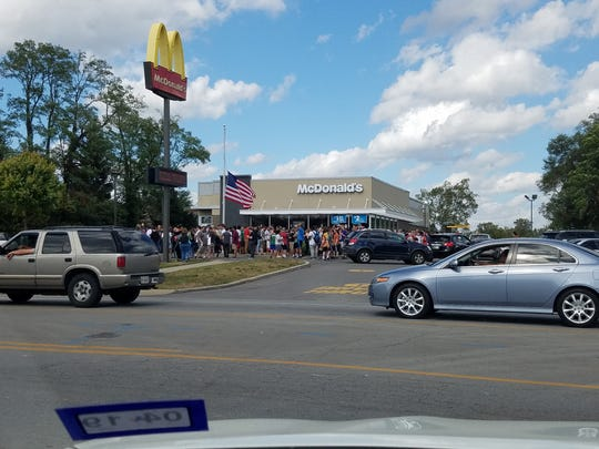 Hungry McDonald's customers wait to get their hands on its szechuan sauce Oct. 7, 2017.