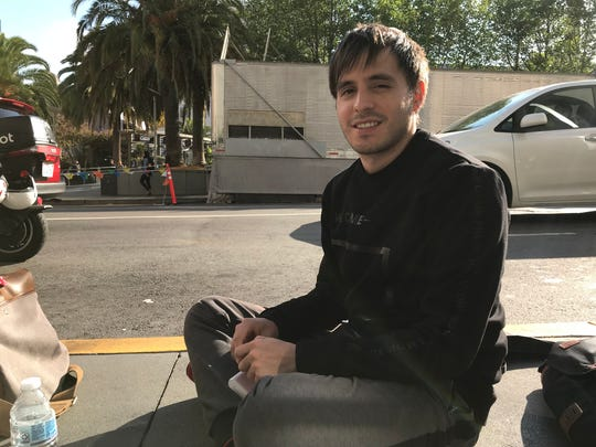 Erick Ballesteros, 27, waiting in line at Apple's flagship