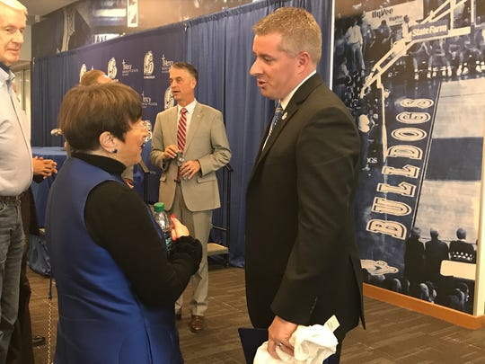 Drake athletics director Brian Hardin talks with Suzie Glazer Burt after a news conference introducing Hardin on Thursday, Nov. 10, 2017, at the campus' Shivers basketball facility.