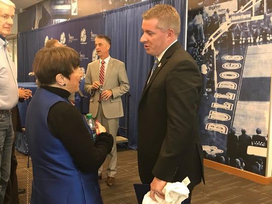 Drake athletics director Brian Hardin talks with Suzie