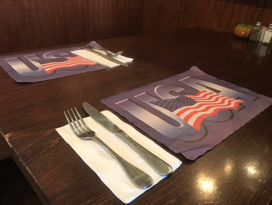 USA place settings on the tables at Halligan's Public