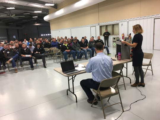 Jane Landretti of the Wisconsin Department of Natural Resources lays out the ground rules for a public hearing on CAFO permit applications in Luxemburg.