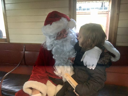 Cadie Lapier, 4, met Santa for the first time on a special sanitized train event put on by the Nevada State Railroad Museum in Carson City on Sunday, Dec. 3, 2017.