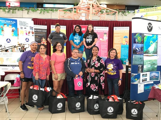 National Preparedness Month Awards Ceremony at Micronesian Mall held Sept. 30. Pictured front row from left: Assistant Principal Aggy Quinata, Drama teacher Darlene Quichocho, Social Studies teacher Esther Yanger, Savannah Tigil, Principal Lynda Hernandez-Avilla. Students not pictured: Jacob Sablan, Ashia Penias, Kathleen Catague and Lisa Rosario. Pictured back row GHS Staff from left: Ashley Rote, Maria-Loralyn B. Romulo and Jamie Cruz.