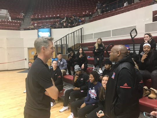 Warriors coach Steve Kerr chats with the Detroit Mercy