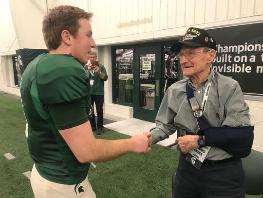 Howard Grider, 92, shakes hands with MSU redshirt freshman