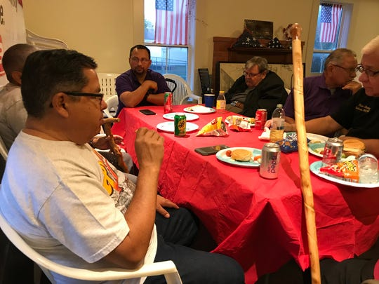 "Military veterans eat while they talk about the Christmases they missed while serving in the military during ""Christmas We Missed"" on Wednesday, Dec. 20, 2017, at the Veterans Band house in Heritage Park."