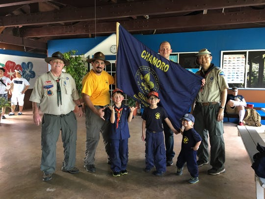 The Boy Scouts of America, Chamorro District completed its annual scavenger hunt on Dec. 30, 2017 at the Talofofo Falls Park. It required over five miles of hiking, orienteering skills and included nature photography and cultural awareness.  Twelve teams competed comprised of Cub Scouts, Boy Scouts, relatives and friends.  The winning team featured is from Troop 23 Wild Cats. Pictured from left: Bradley Hokanson (District Deputy Commissioner congratulating the team), Alex Bedoya, Gabriel Pope, Alex Bedoya, James Pope, Antonio Bedoya, Roy Tsutsui (Scavenger Hunt Creator and Manager congratulating the team) Photographer: Olivia Bedoya (team member)