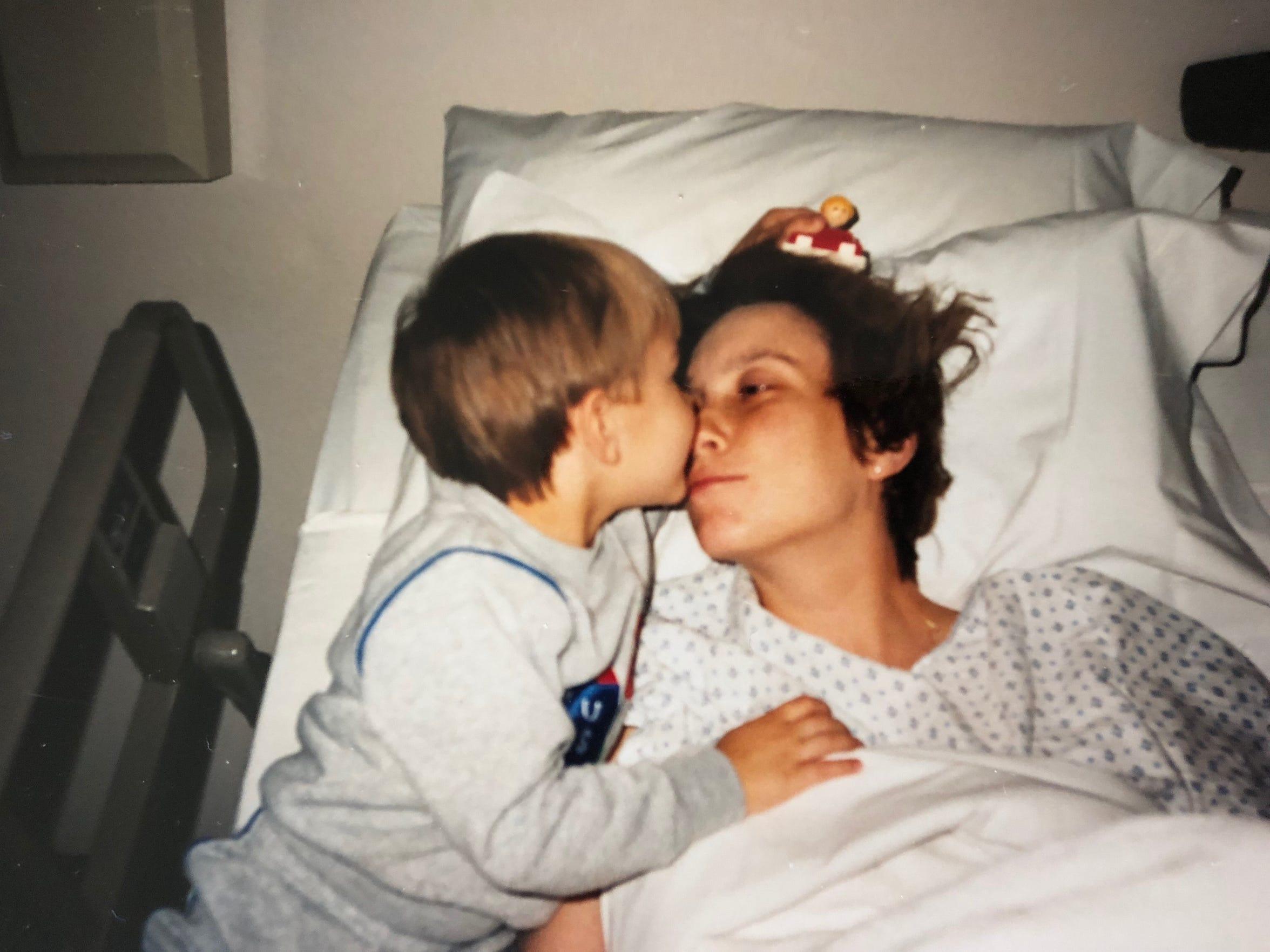 Angela Klier-Brunk, 60, of Des Moines, kisses her oldest