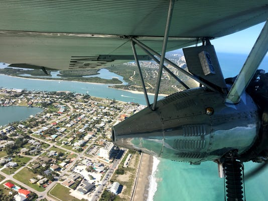A restored 1929 Ford Tri-Motor airliner flies over South Beach and the Fort Pierce Inlet on Thursday Feb. 15. The plane, one of only six Tri-Motors still ...