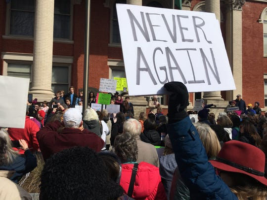 Roughly 200 marchers converged Saturday at the Augusta