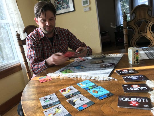 Matt Kirsch deals out a game of Quester Party. It's the first game that Kirsch is launching under his game design label Tiger Ghost.