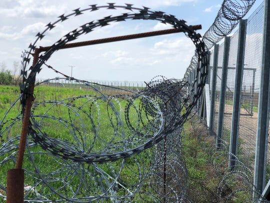 Barbed wire is seen near the end of border fence in Hungary near the country's international boundary with Serbia and Romania, on April 13, 2018.