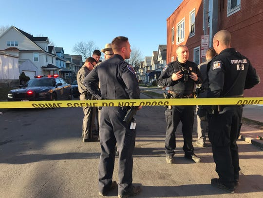 Police at the scene of a fatal shooting on Sidney Street