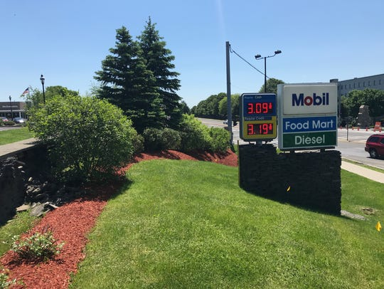 A sign at the Mobil station on North Road in the town