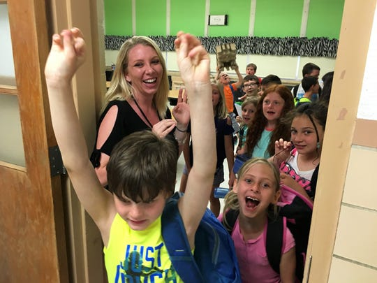 Second grade teacher Kristen Orians says goodbye to students on the last day of school at R.C. Waters Elementary School.