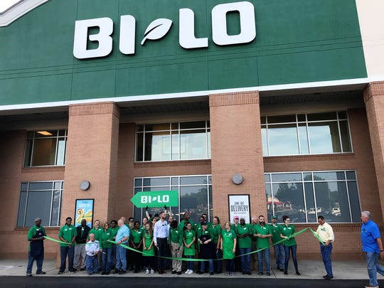 Workers at the Verdae Boulevard BI-LO in Greenville celebrate their newly remodeled store in a ceremonial ribbon-cutting Thursday morning, June 14, 2018.