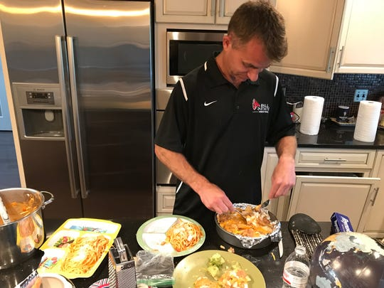 James Whitford cooks dinner at his home.
