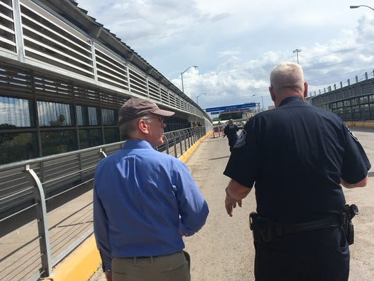 Rep. Peter Welch, D-Vt., walks with a border agent