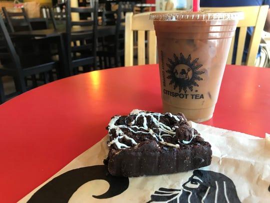 A medium iced coffee and raspberry tango brownie at