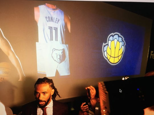 Memphis Grizzlies guard Mike Conley speaks to reporters Thursday after the team unveiled a refreshed logo and color scheme at FedExForum.