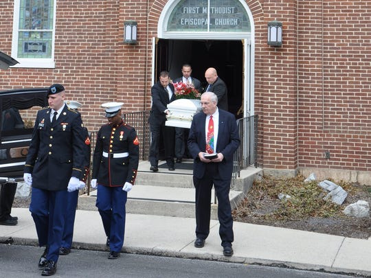 Pallbearers carry the casket of 3-year-old Weston Rock February 27 after a funeral service at First United Methodist Church in Mercersburg.